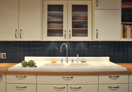 Salvaged sink with glass tile backsplash